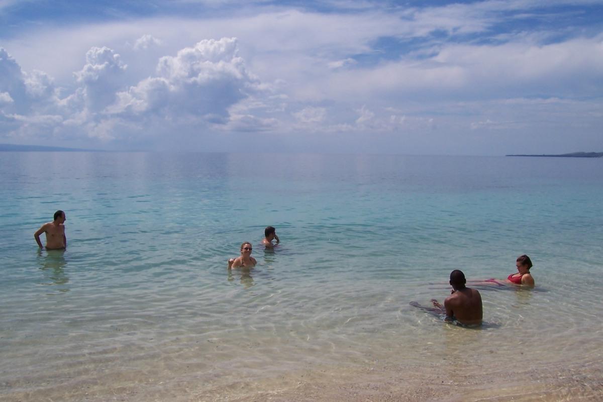 friends in the water at wahoo bay haiti