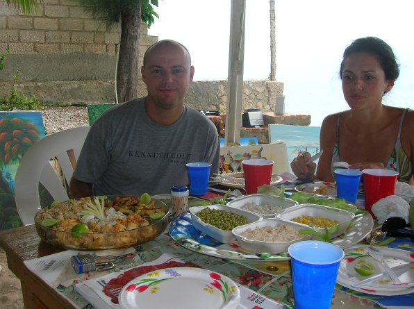 at the beach eating seafood in Haiti
