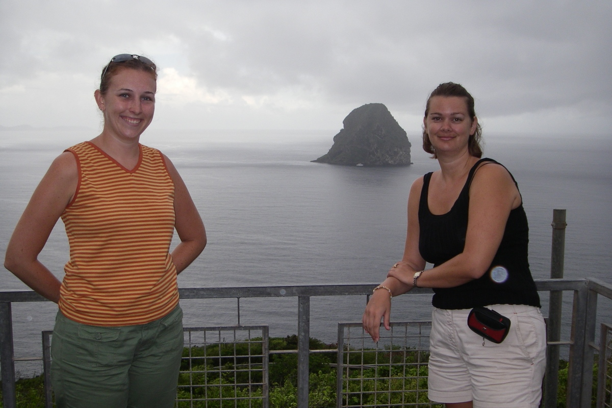 girls standing in front of the Green Diamond in Martinique