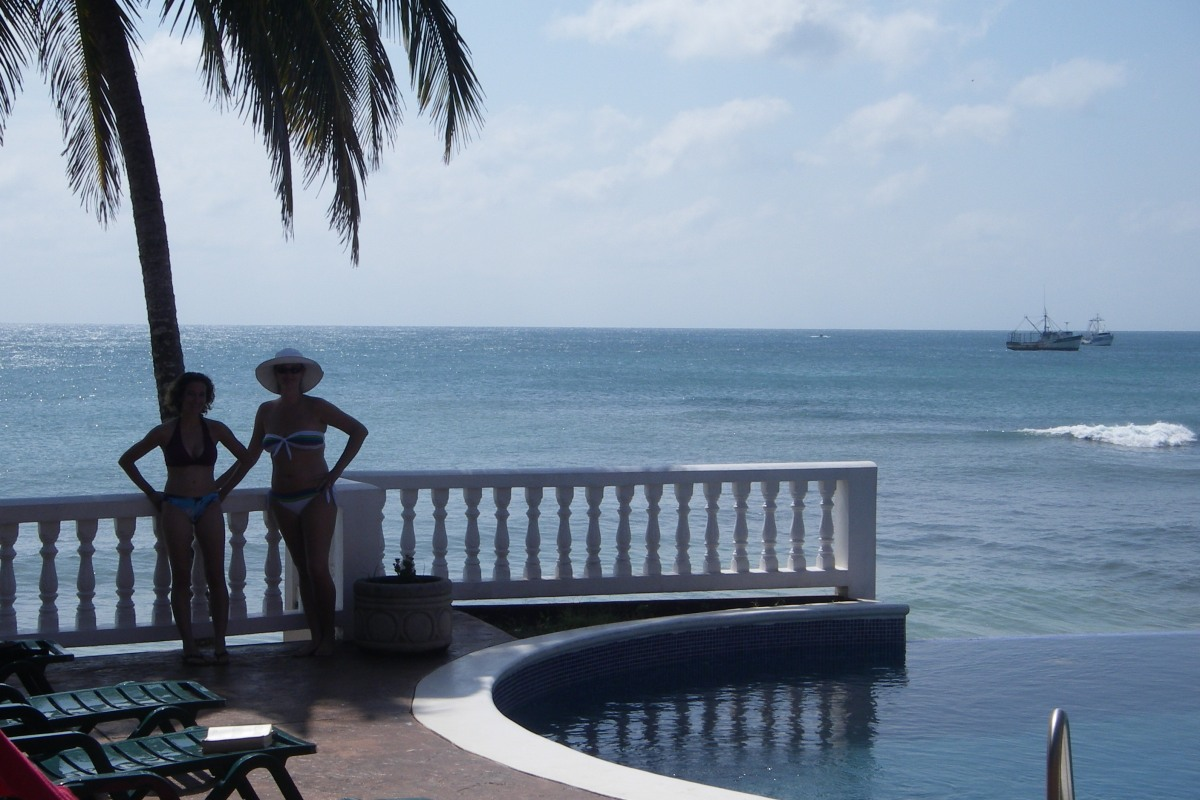 two girls in bikinis Corn Islands hotel and pool Nicaragua