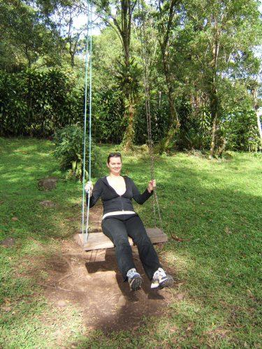 girl on swing at selva negra nicaragua