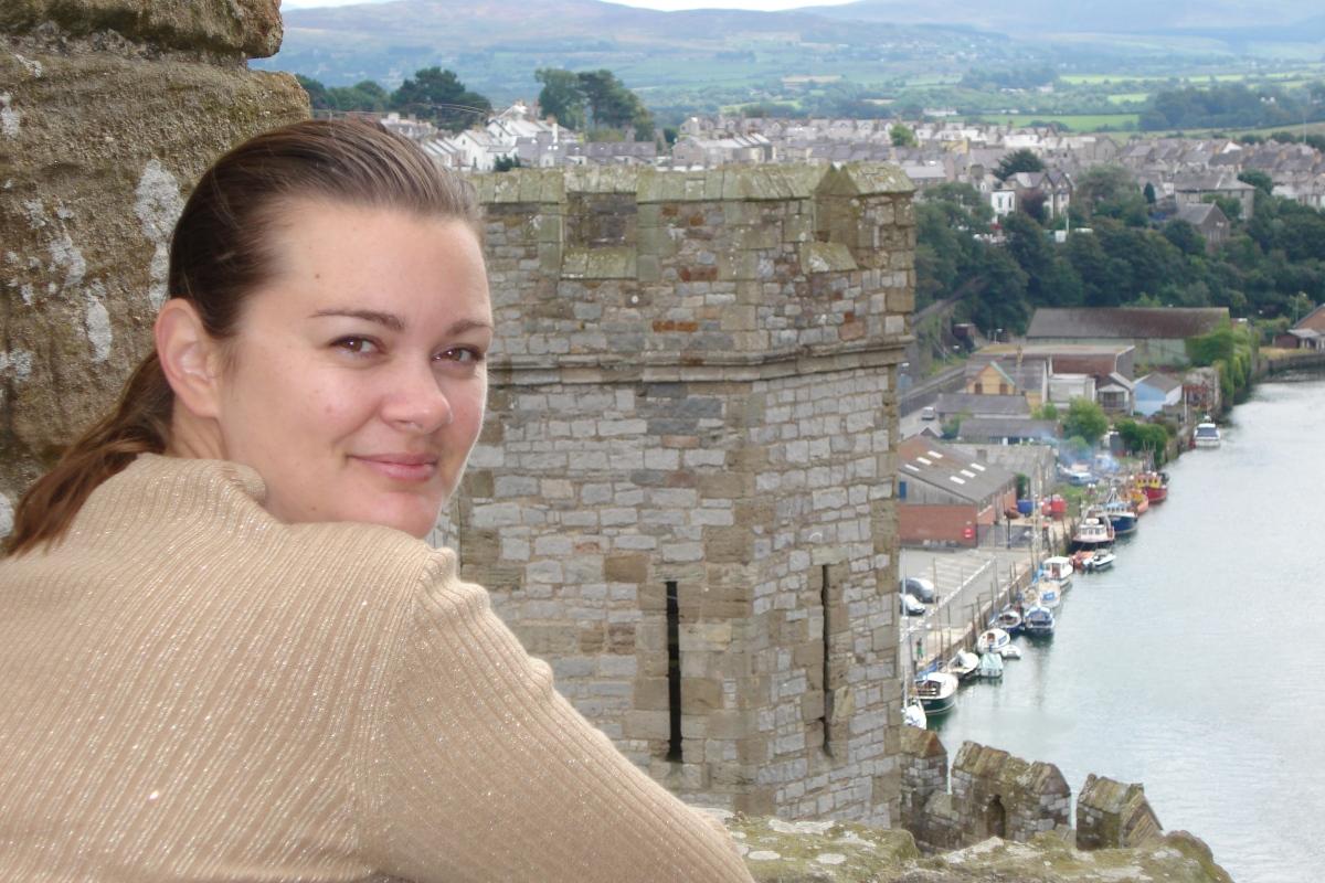 girl atop caernarvon wales castle