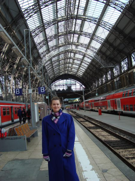 woman in long coat at frankfurt train station