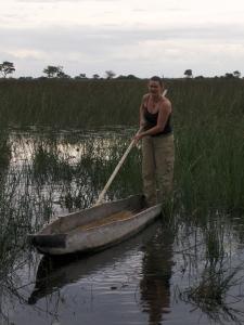 girl on mokoro canoe in okavanga delta botswana