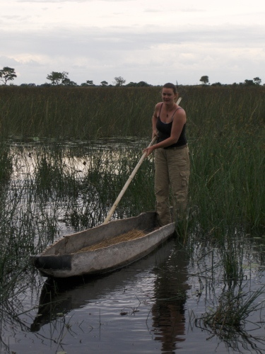 girl on mokoro canoe in okavanga delta botswana