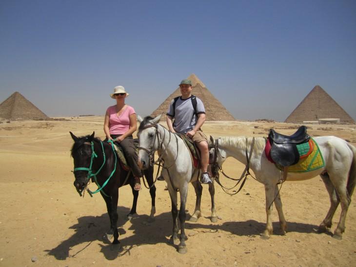 couple on horses pyramids giza cairo egypt