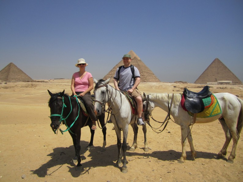couple on horses pyramids giza cairo egypt