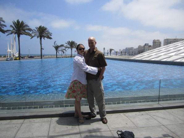 couple in front of water at library of alexandria egypt