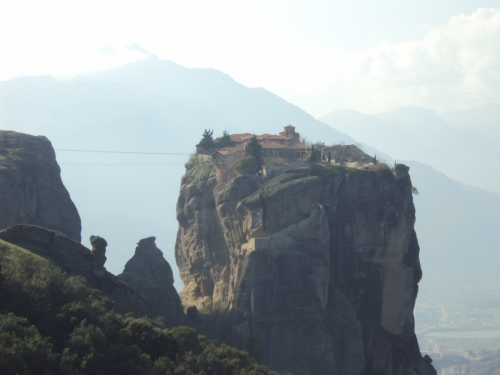 Monastery perched on cliff in meteora greece