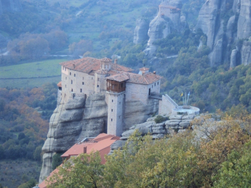 overview of monastery perched on mountaintop meteora greece