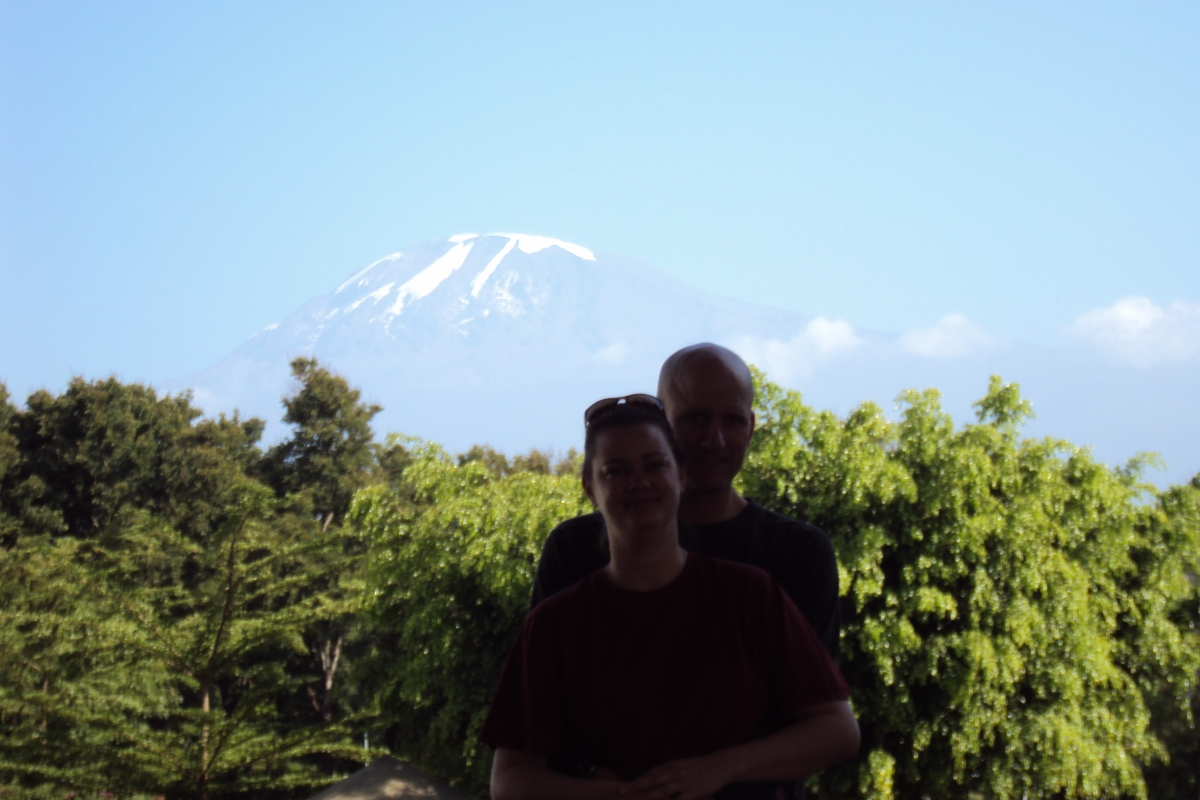 couple at bottom of mount kilimanjaro tanzania