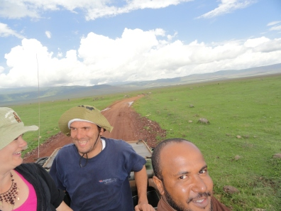 three friends on safari game drive ngorongoro creater kenya tanzania