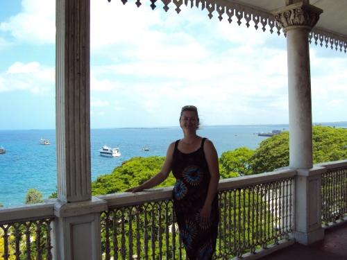 girl standing on balcony zanzibar tanzania