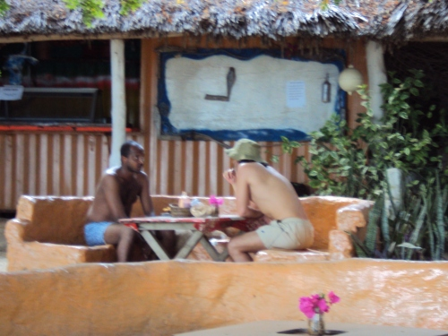 boys sitting at table mombasa beach kenya
