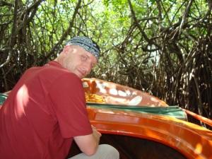 man in boat on river safari sri lanka