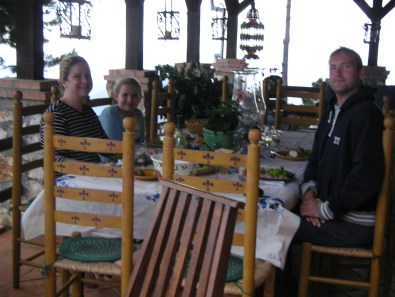 family at outdoor dinner table