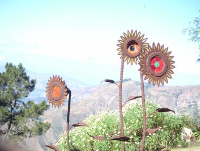 Mountain house sunflowers iron sculpture Haiti