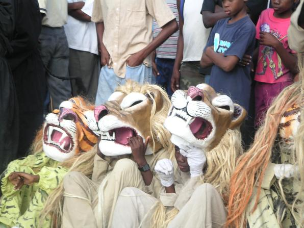 four little boys in tiger costumes jacmel haiti carnival