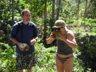 Tom and Deah with coconut snack in Haiti Jacmel
