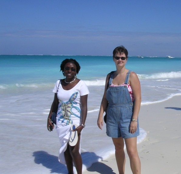 two friends on the beach at turks and caicos island