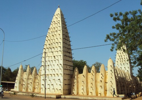 sand mosque in bobo dialassou burkina faso white mosques with sticks poking out