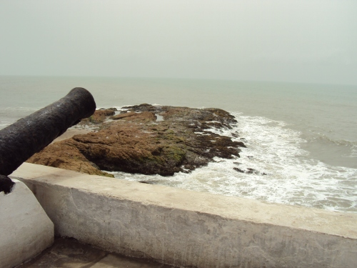 cannon and coastline cape coast slave castle ghana africa