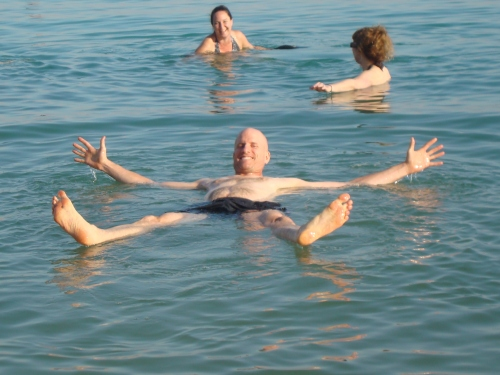 man floating in dead sea israel