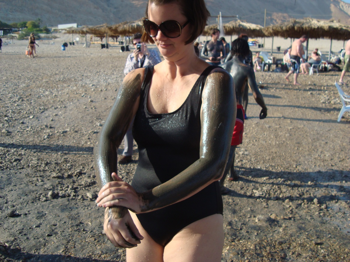 woman applying mud at dead sea israel