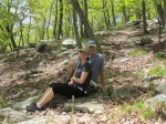 couple sitting on ground in forest berkeley springs west virginia