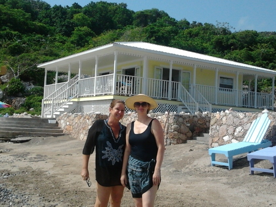 two ladies in swimsuits at beach house in haiti
