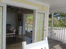 yellow beach house with white trim