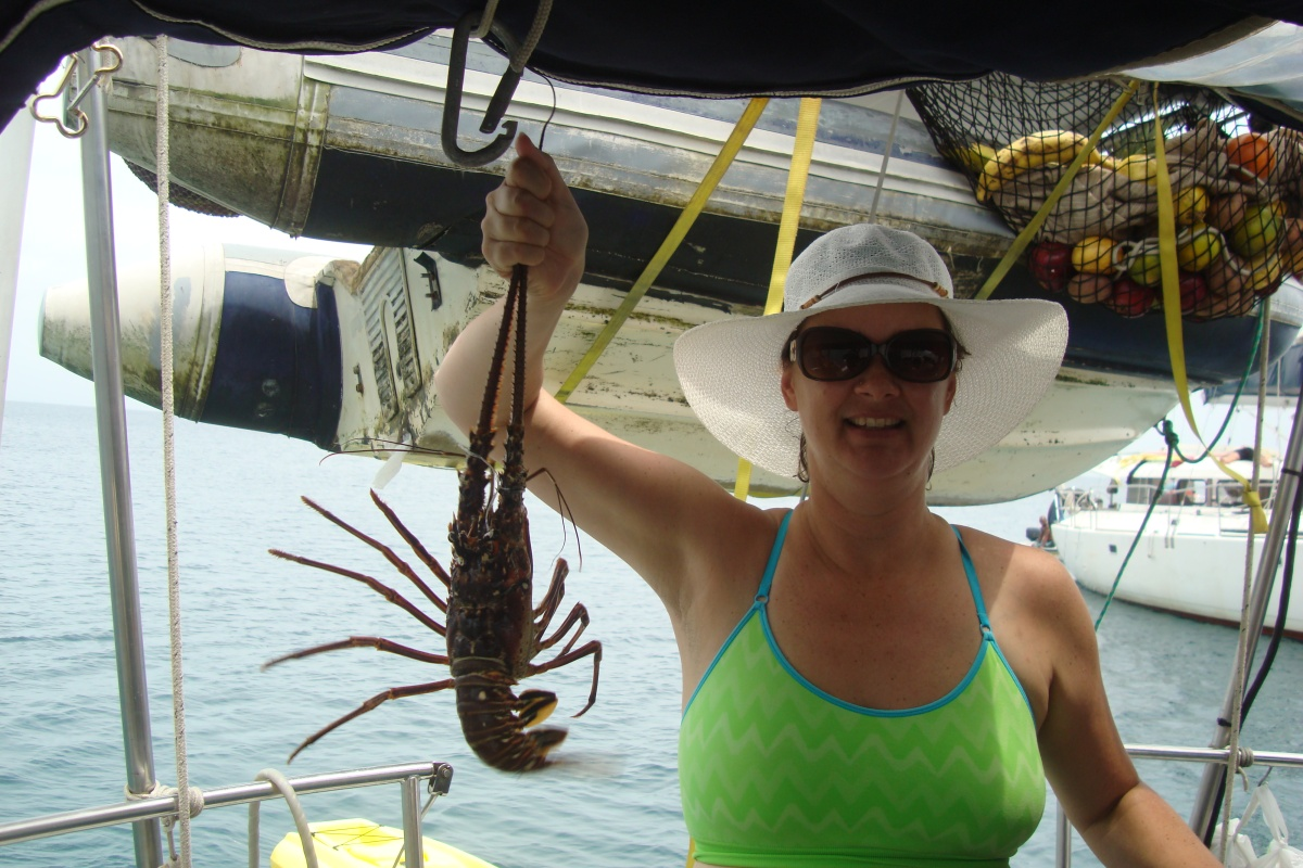 woman with lobster sailboat panama sailing