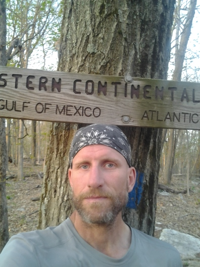 hiker at Eastern continental divide sign appalachian trail