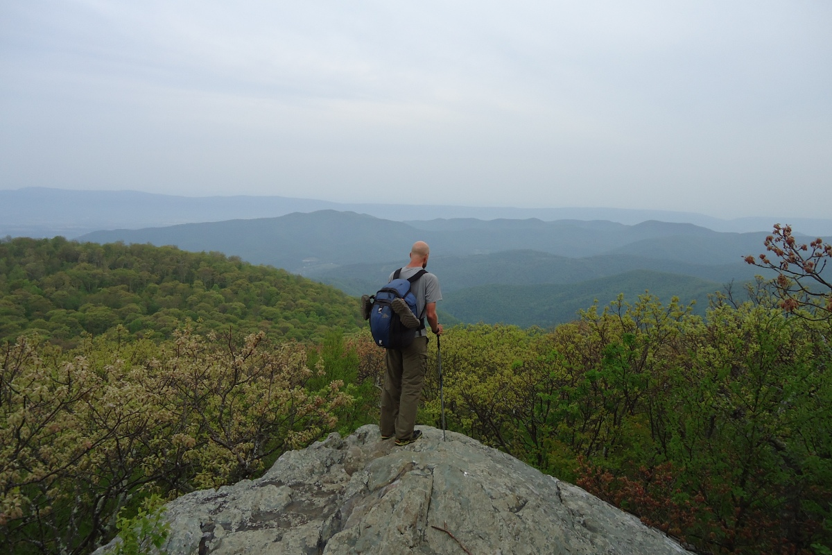 Hiker faces a row of mountains on the appalachian trail