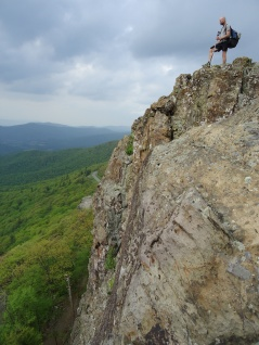 Hiker on rock outcropping Appalachian Trail Virginia