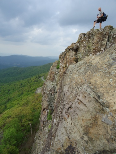 Hiker on rock outcropping Appalachian Trail Virginia