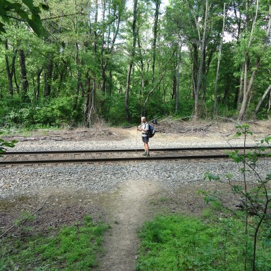 Hiker standing on railroad tracks appalachian trail virginia
