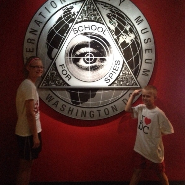 Kids in front of International Spy Museum sign Washington DC