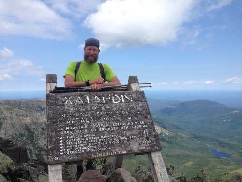 Chris at the Katahdin sign mount Katahdin maine end of appalachian trail
