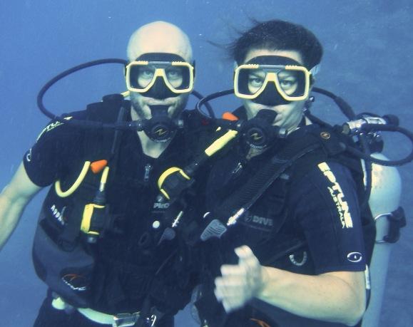 Great Barrier Reef couple scuba diving Australia