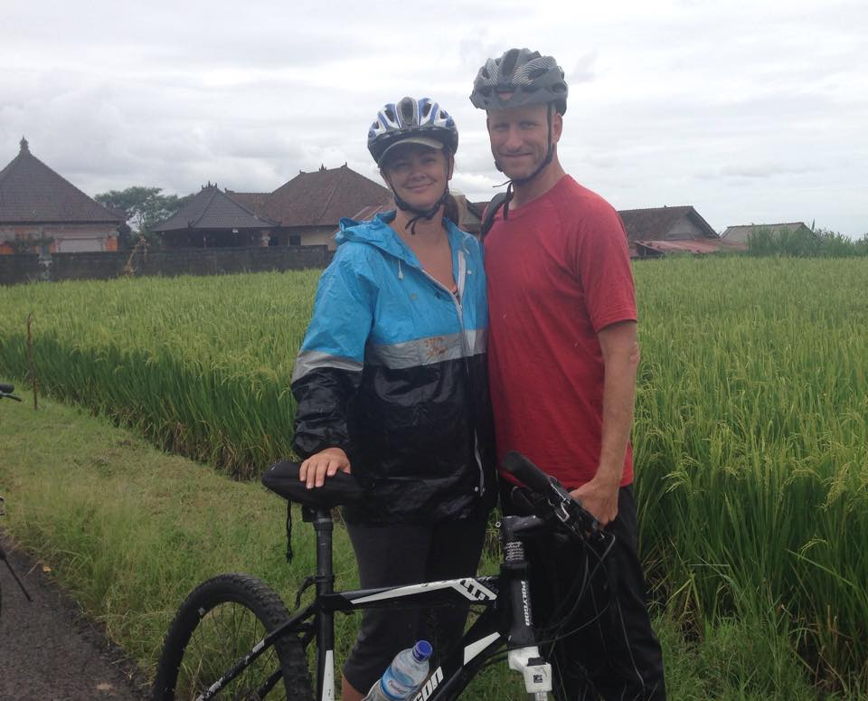 Deah and Chris on bikes in Bali rice field Ubud