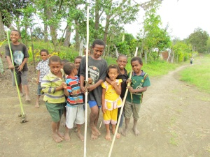 Papua New Guinea highlands village kids with homemade toy cars