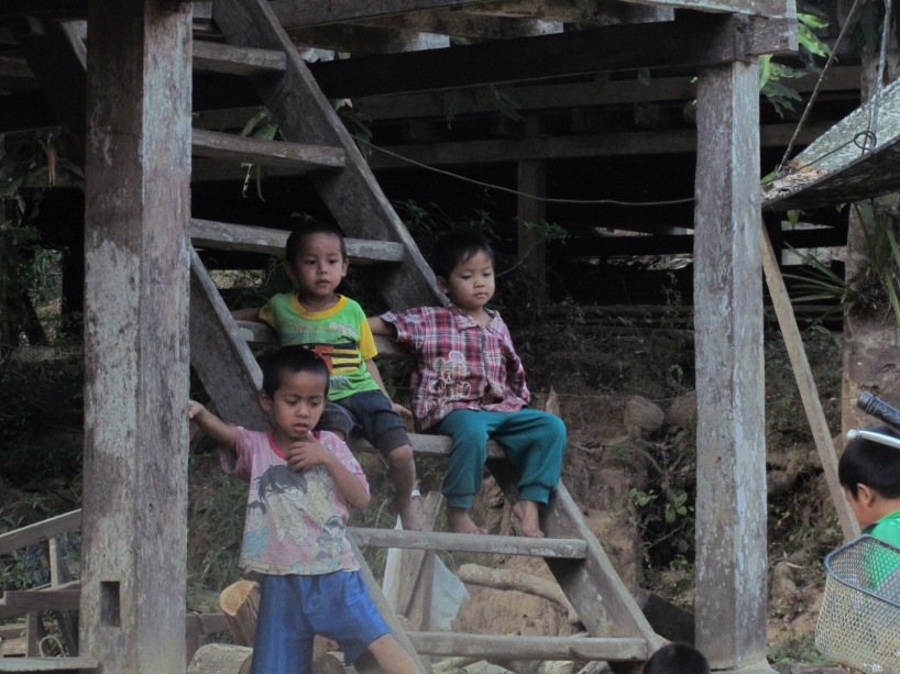 village kids Laos homestay stray bus