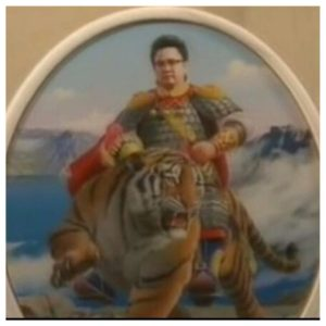 Kim Jung Il riding a tiger wearing armor