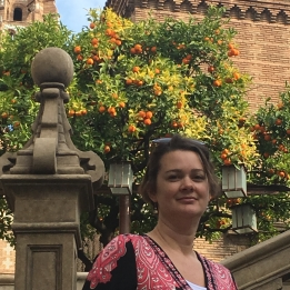 Deah in front of orange trees in Spanish Village Valencia section