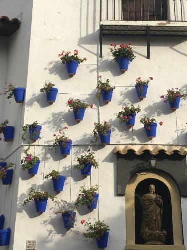 blue terra cotta pots outside white andalusian house