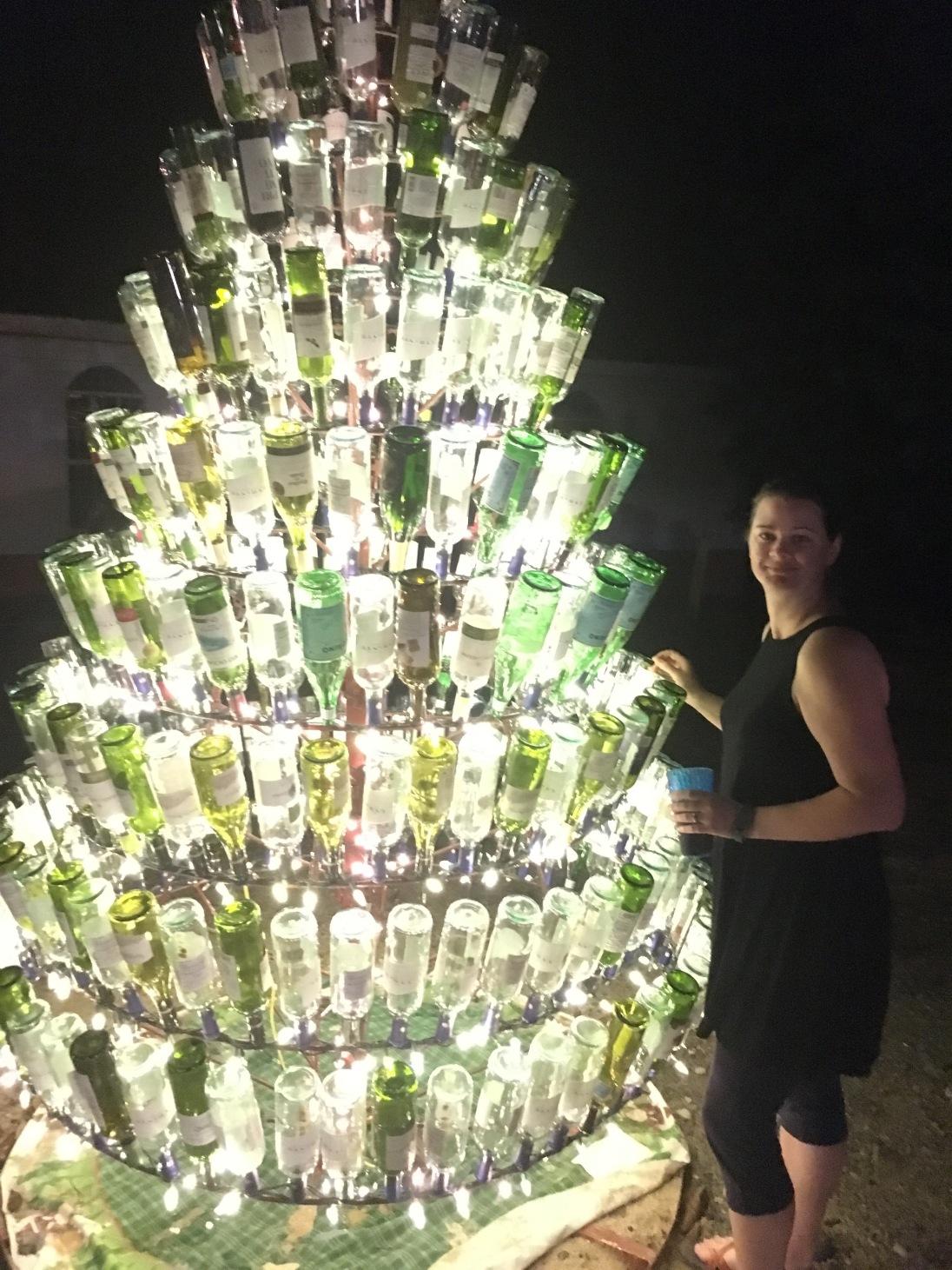 Deah in front of glass bottle Christmas Tree Roatan Honduras