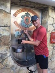 Filling up at a wine fountain, Camino Santiago