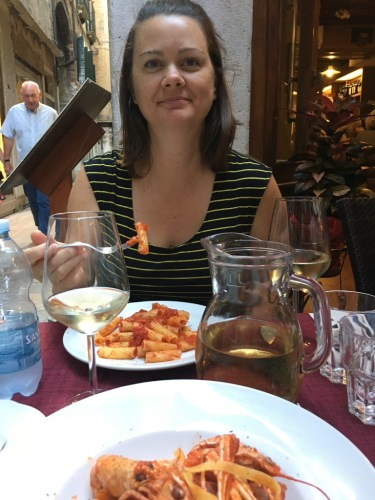 Deah eating pasta in Venice Italy
