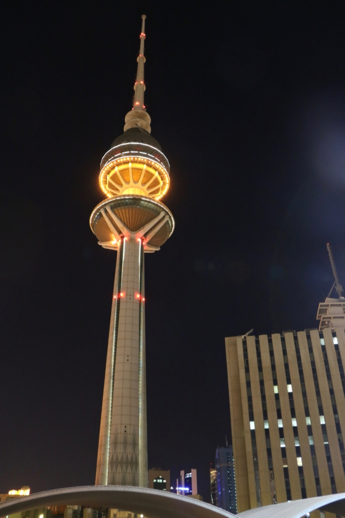 Kuwait Towers lit up at night